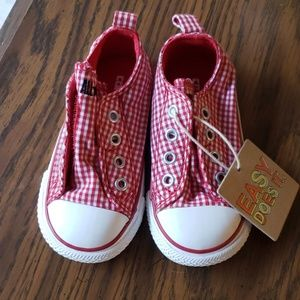 Red gingham slip on Converse.